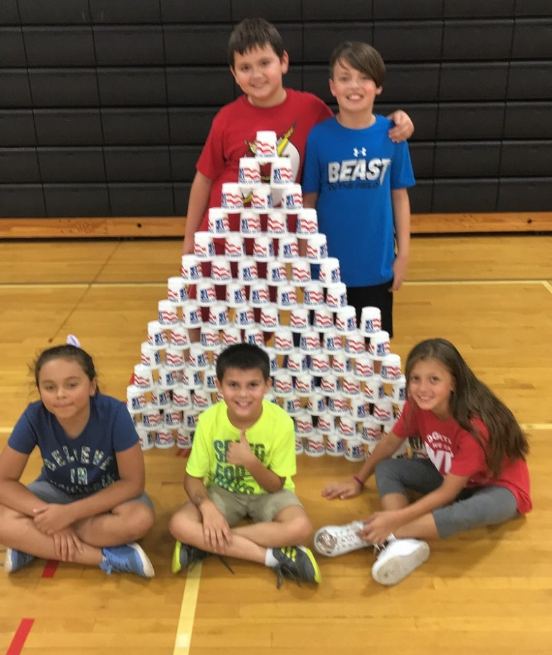 cardio cornhole stacking cup activity
